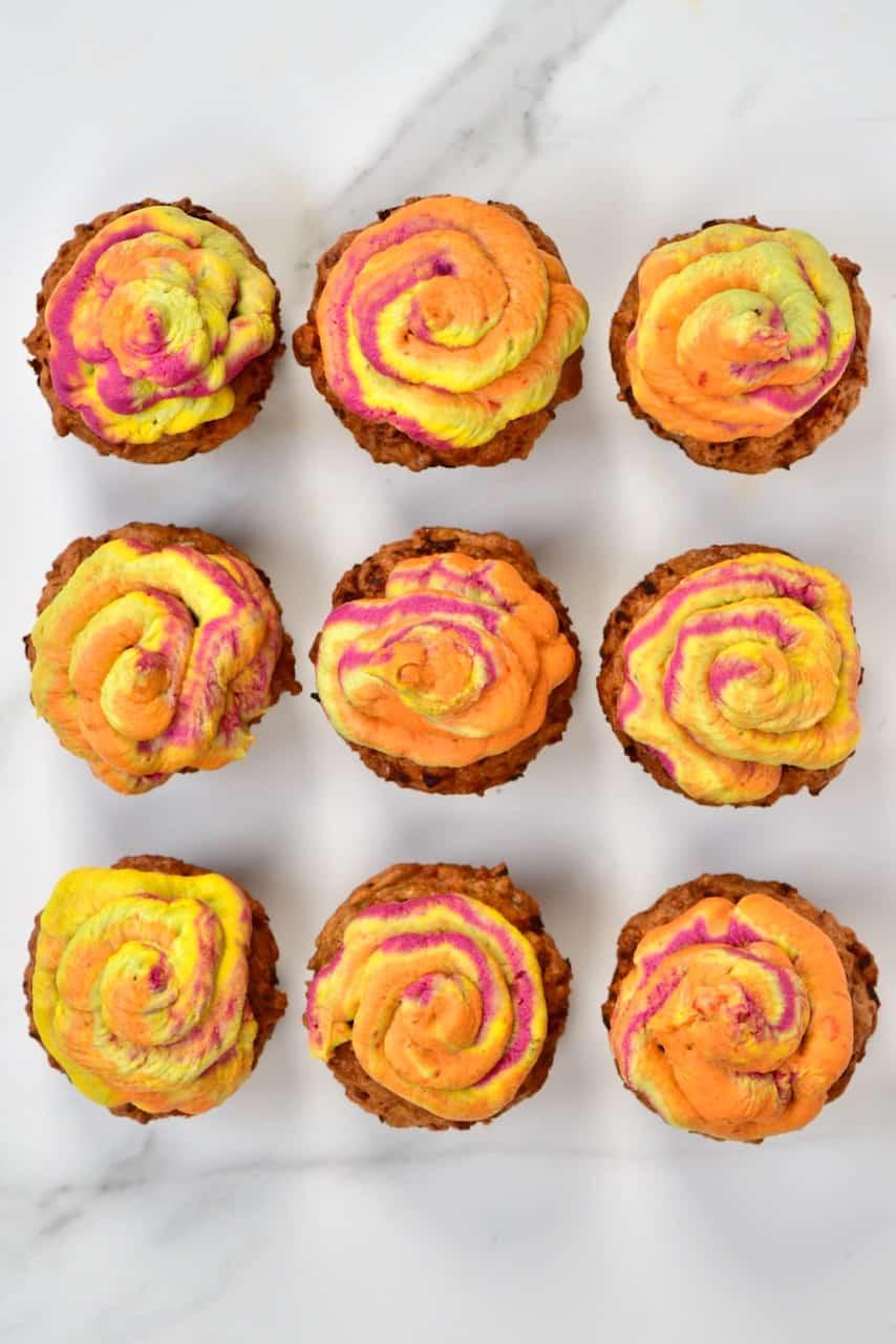 Nine savoury cupcakes with rainbow hummus