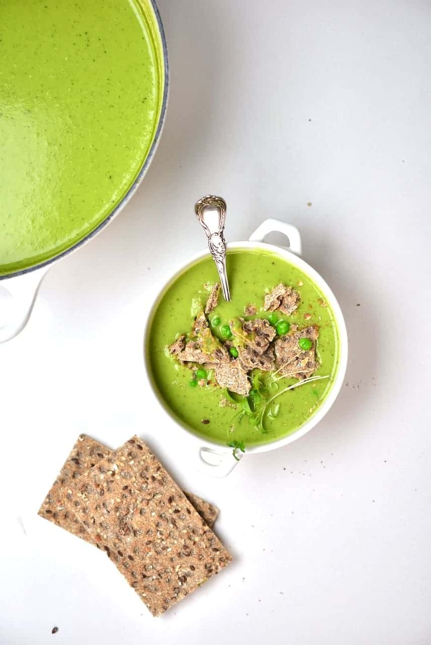 Pea soup in a bowl and crackers