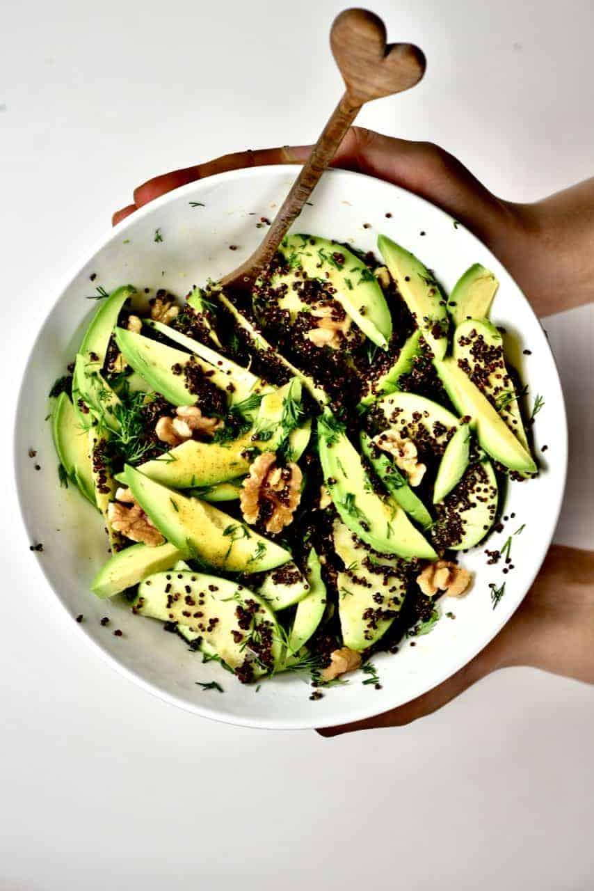 Serving a quinoa apple avocado salad