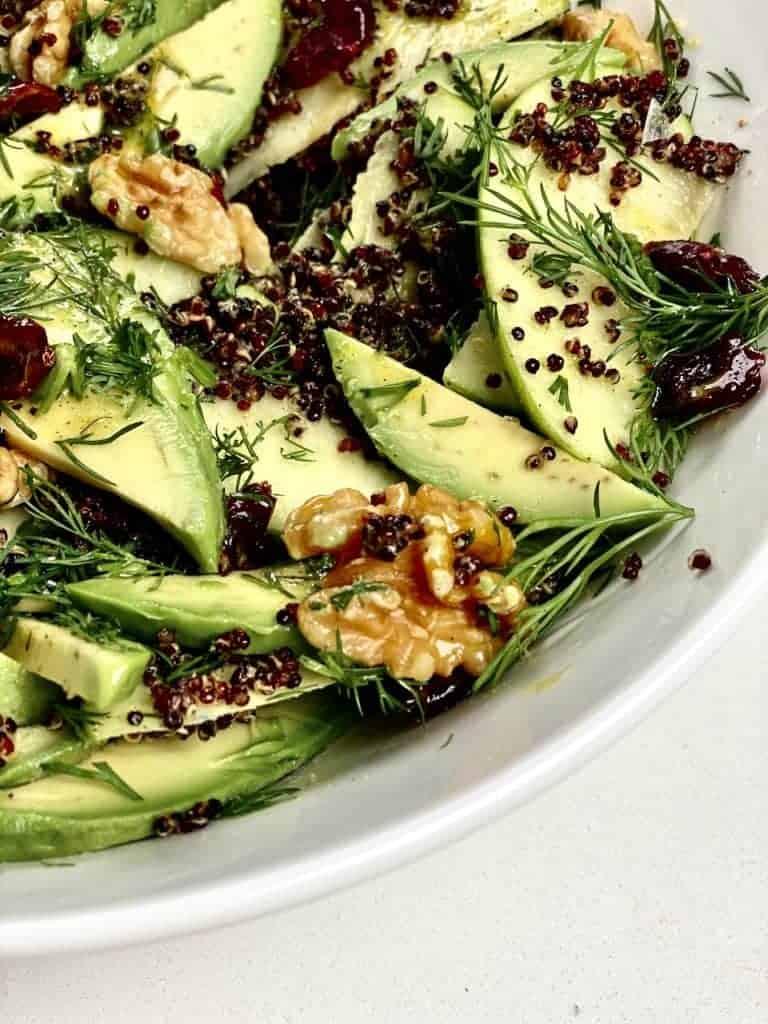 Close up of walnut avocado quinoa salad