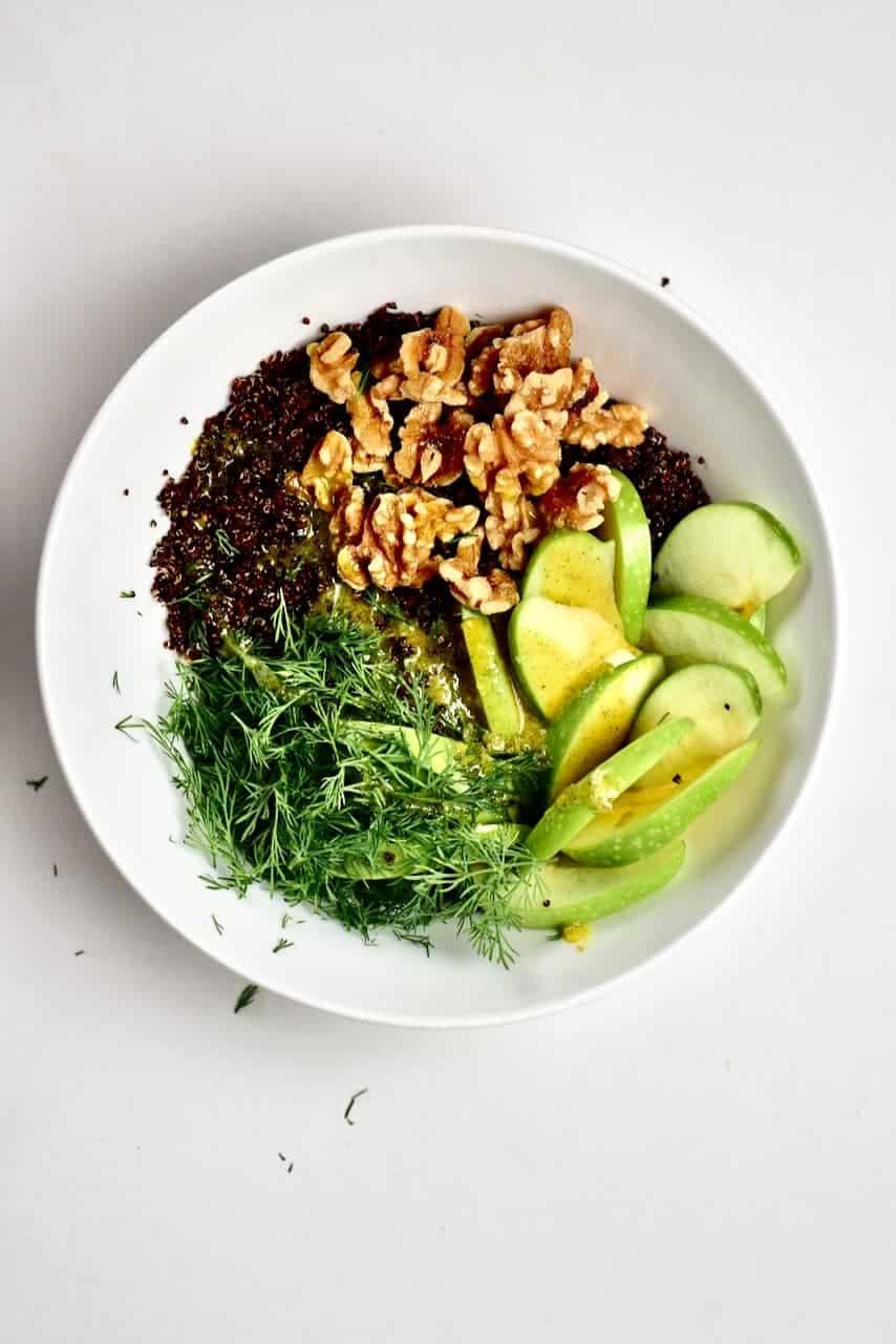 Quinoa walnut apple dill in a bowl