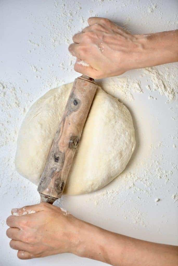 Rolling dough for Spinach Fatayer