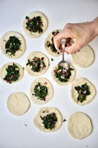 Adding spinach mix