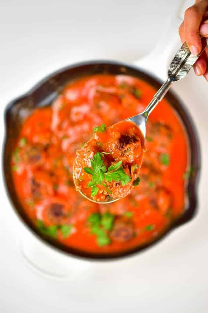 Spoonful of lentil meatballs with tomato sauce