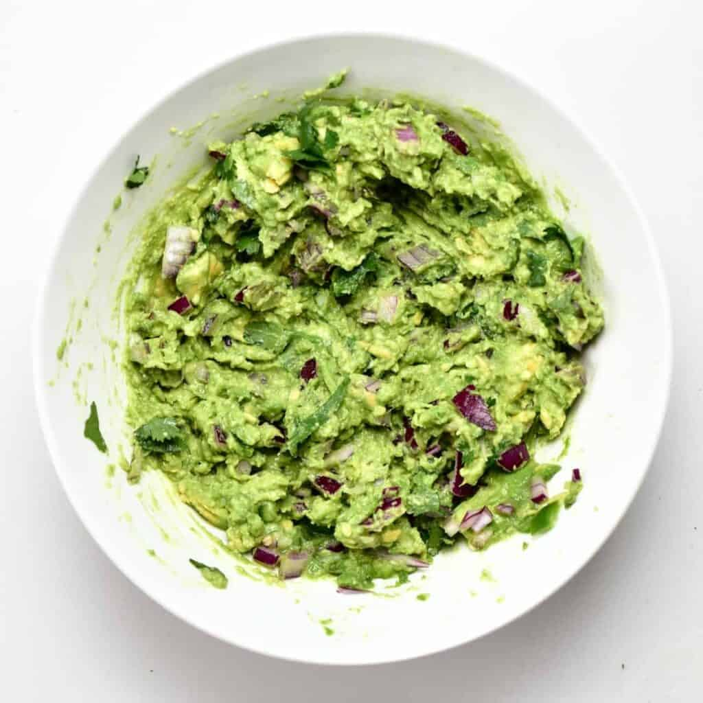 A bowl with homemade mashed guacamole