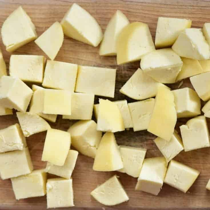 A simple DIY for how to make paneer at home- using just 2 ingredients for this slightly chewy, non-melting, delicious Indian paneer cheese recipe.