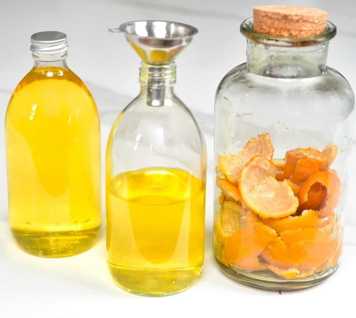 Three jars with homemade citrus cleaner
