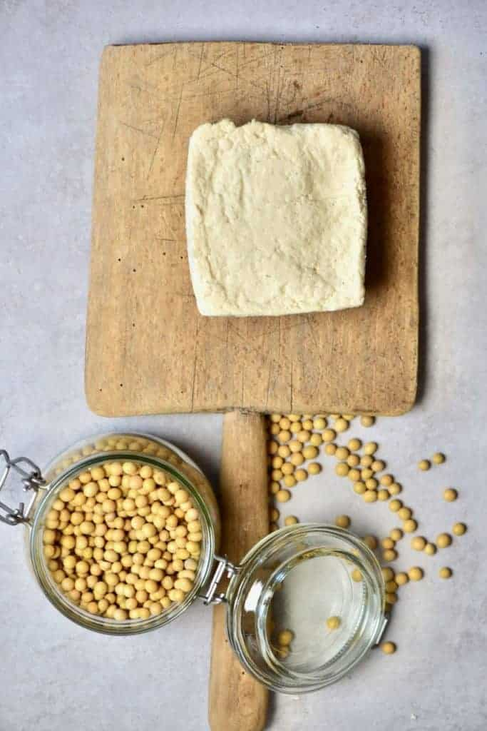 A block of homemade tofu and soybeans
