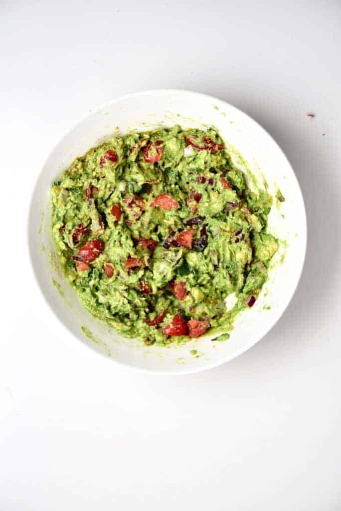 Guacamole and tomatoes bowl