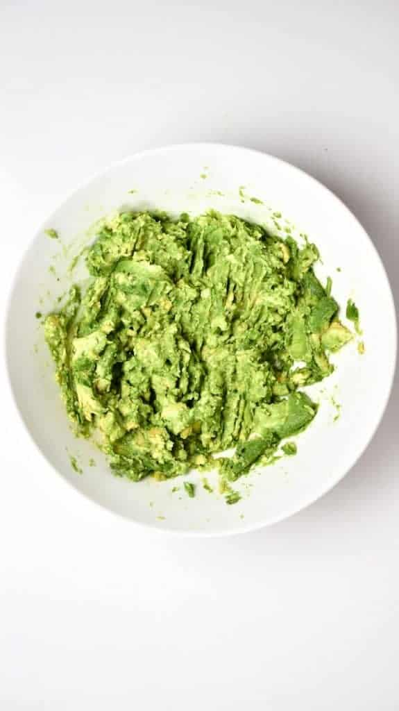 Mashed avocados for Traditional Mexican Guacamole