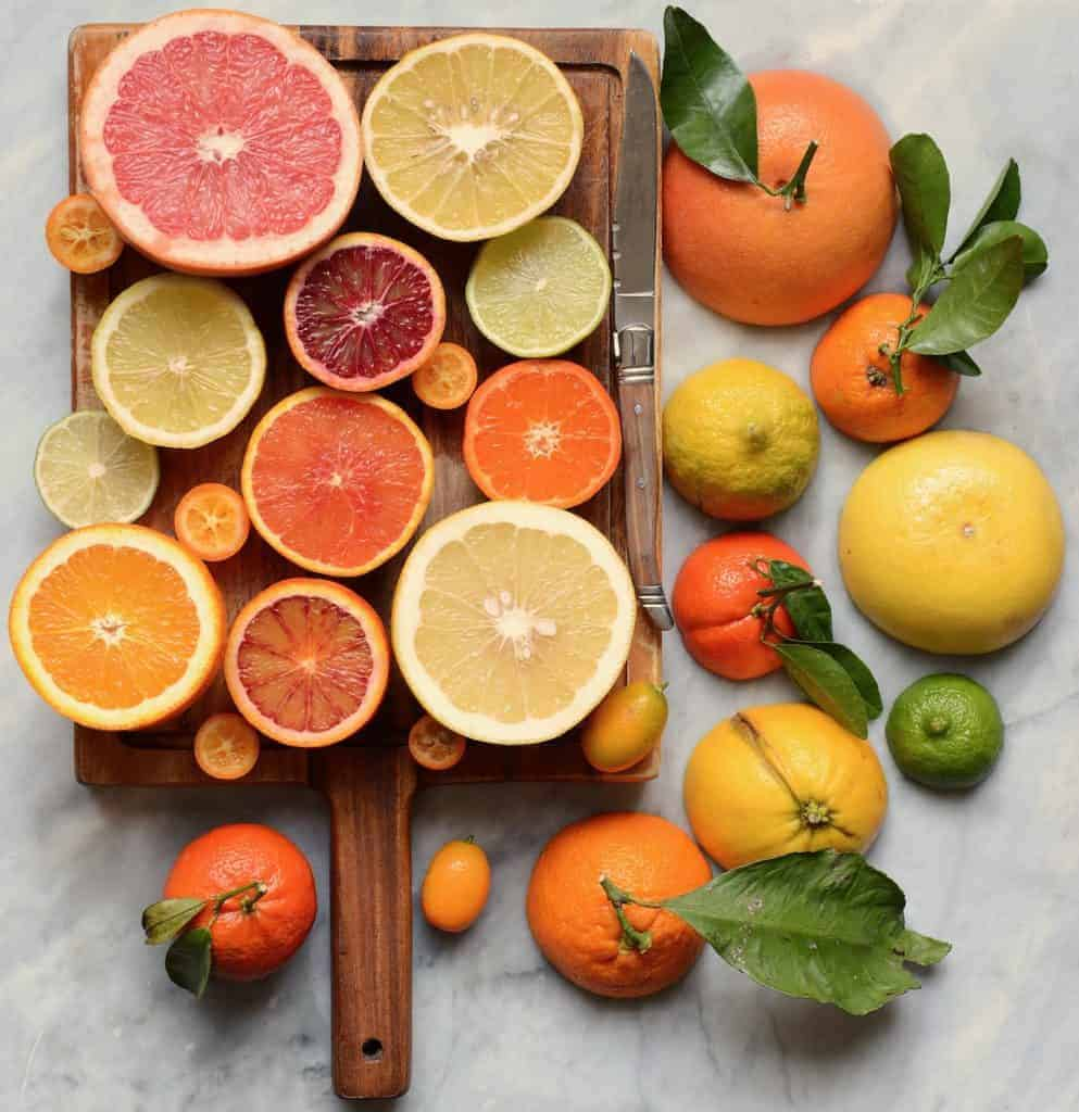 citrus fruits on a wooden board - a wonderful immune boosting foods selection