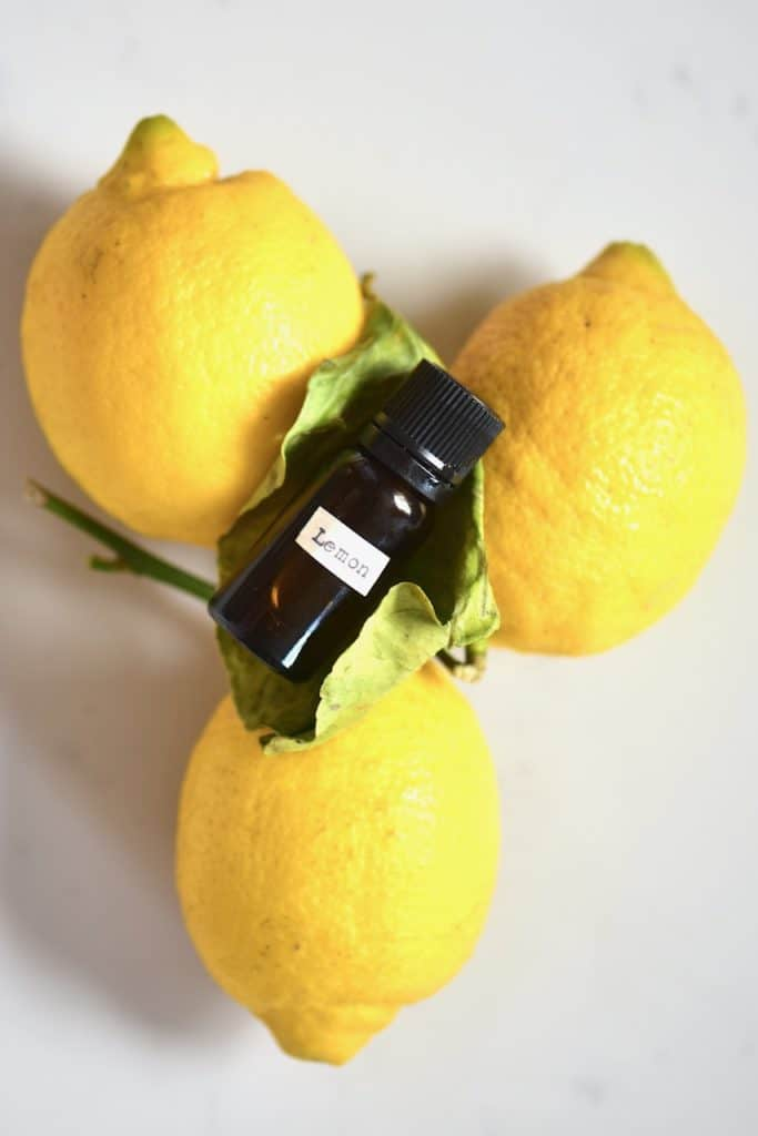 Lemon essential oil and lemons