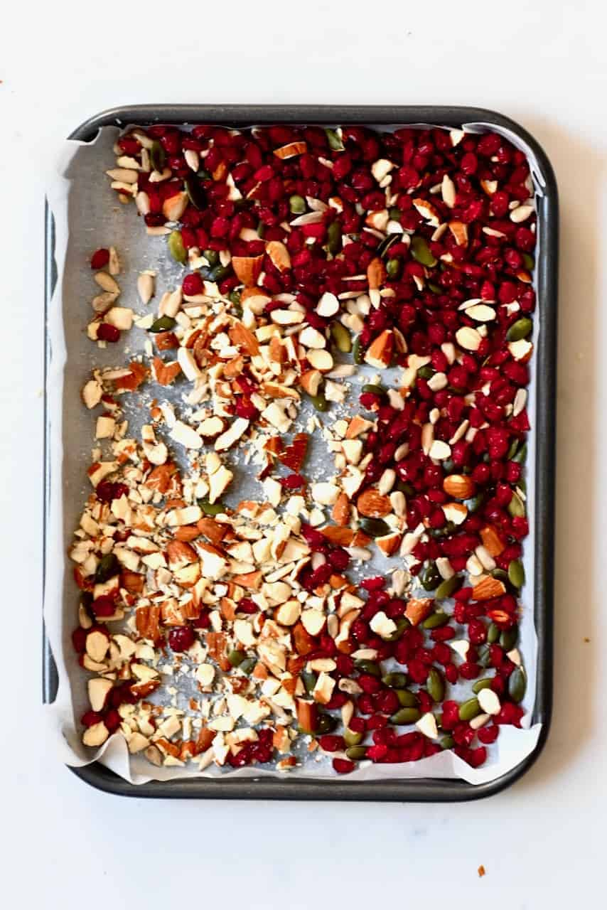 Chopped nuts and fruit poured in tray