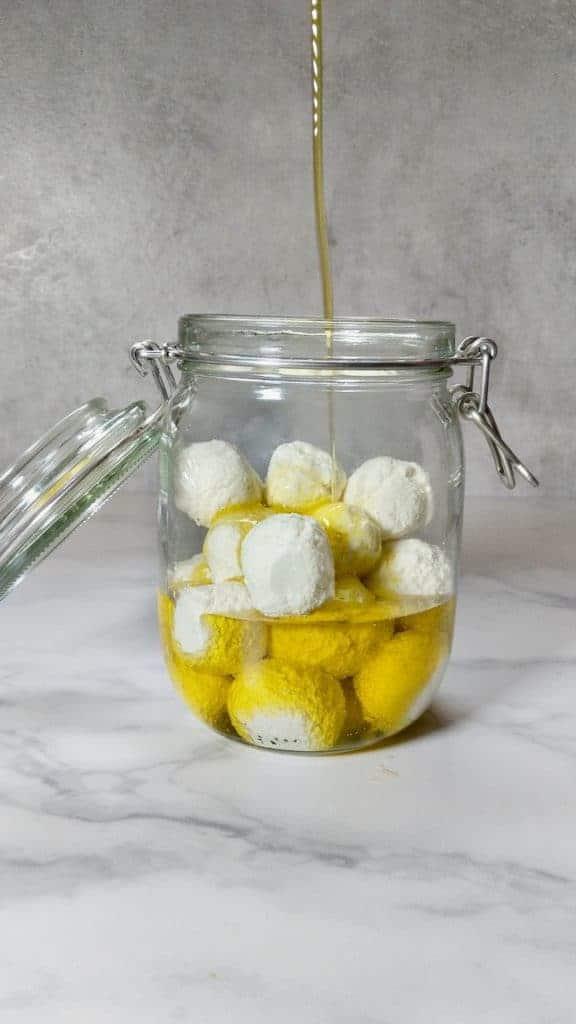 adding oil to jar
