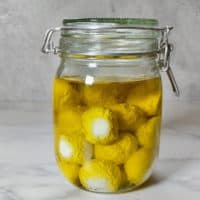 Labneh balls in a glass jar with olive oil