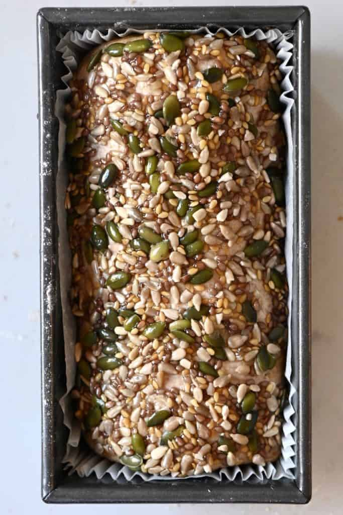 Seeds and grains on top of bread dough