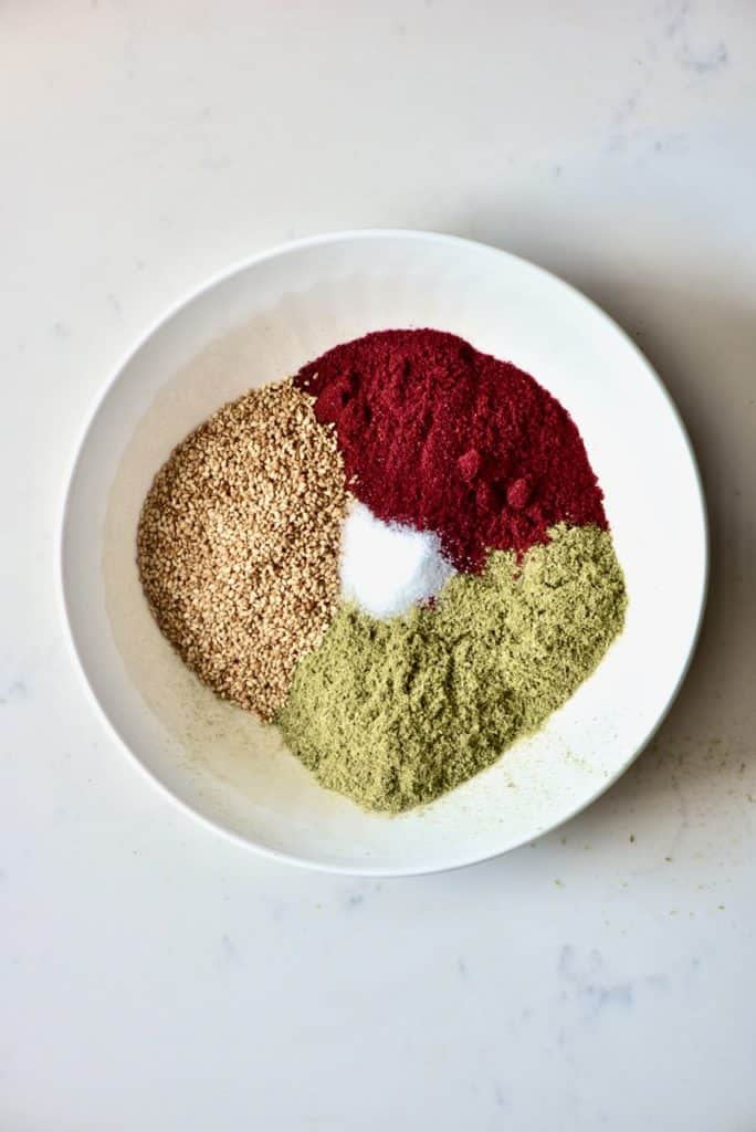 Mixing spices for Zaatar