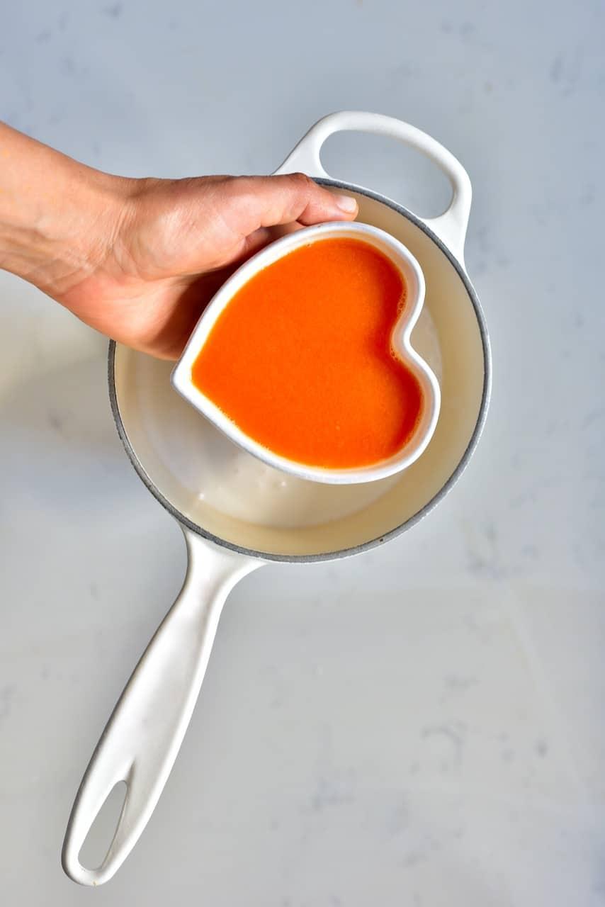 Orange juice added to a pot