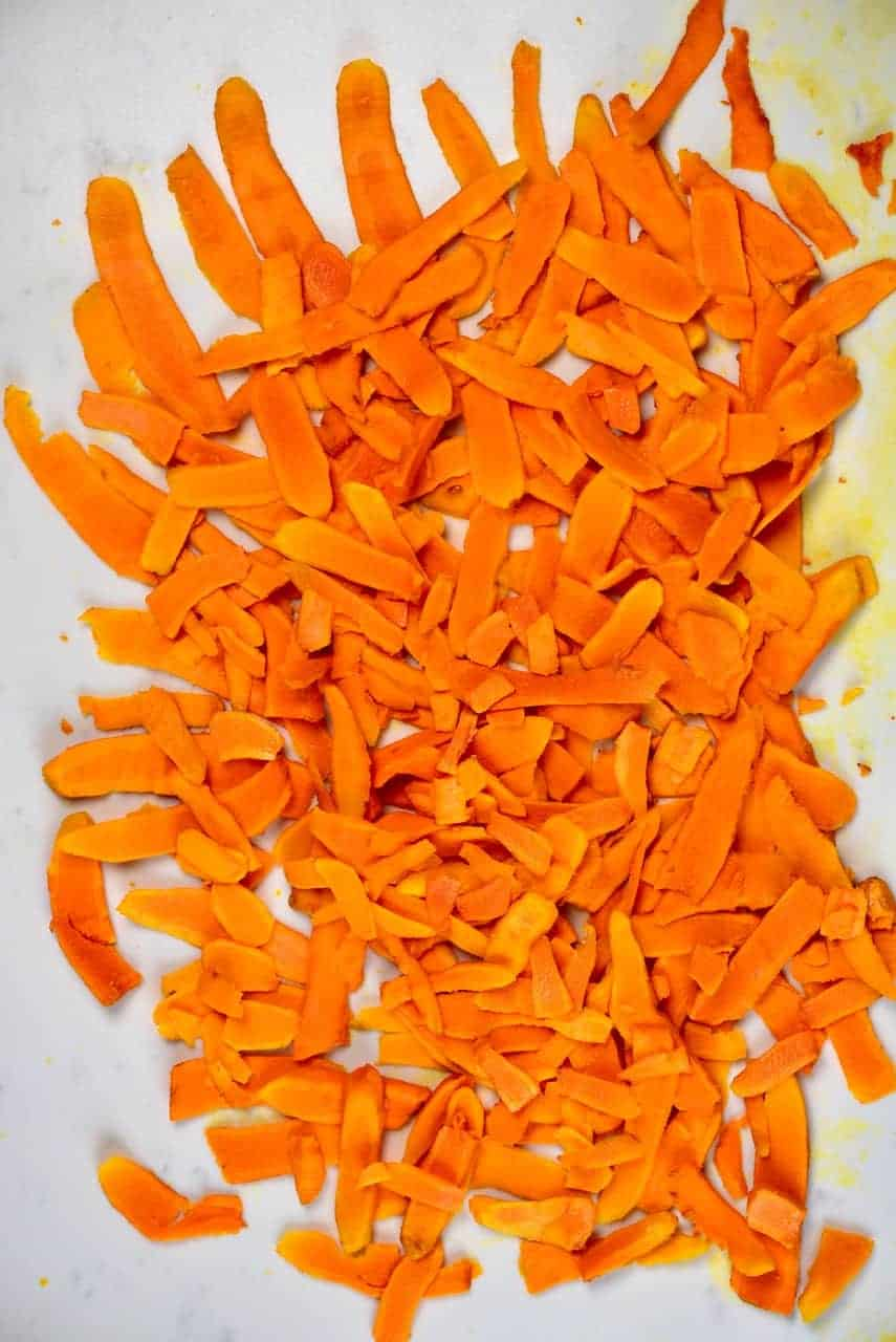 Peeled turmeric root sliced into thin slices