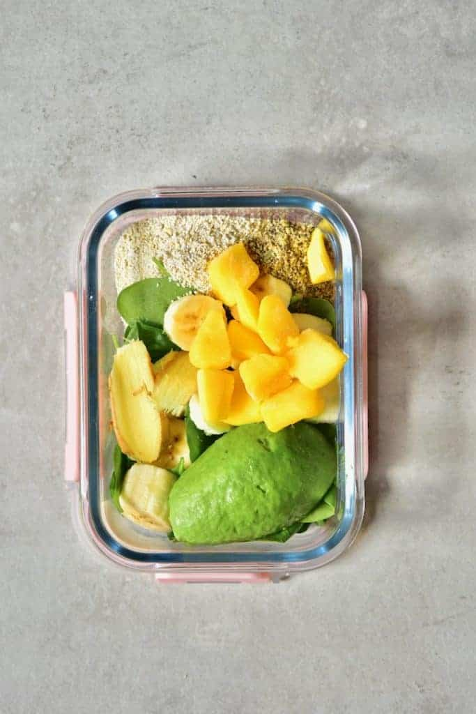 Freezer-safe container with smoothie ingredients