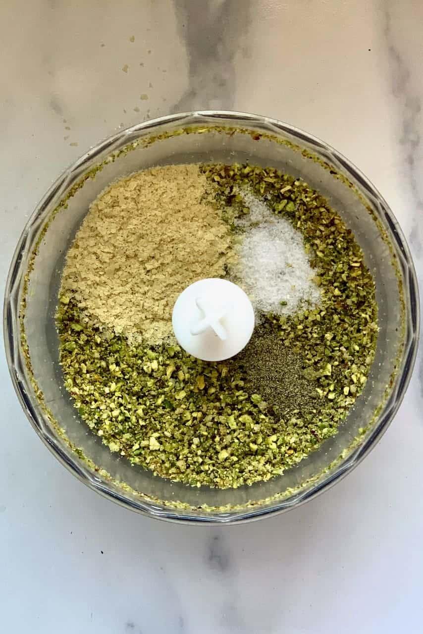 Mixing ingredients for vegan pesto sauce
