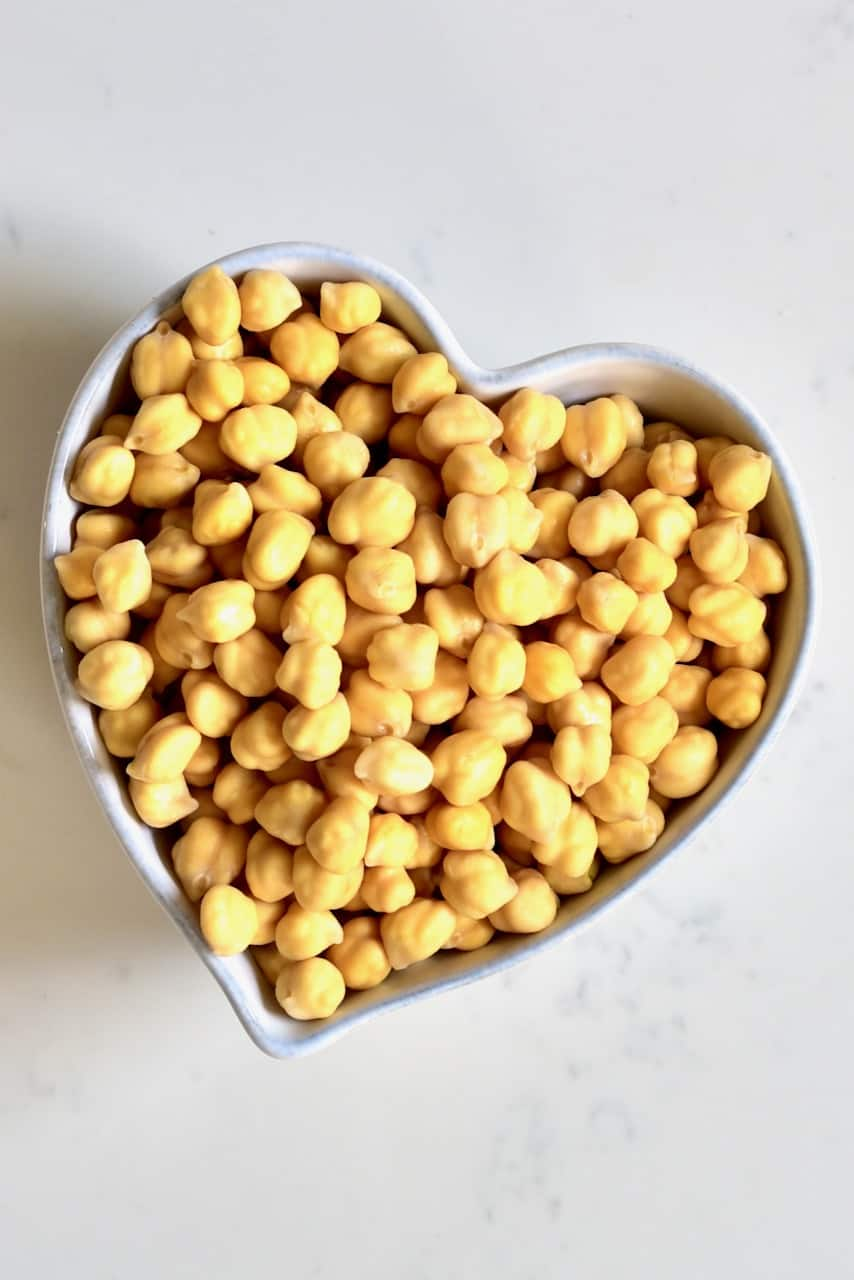 pre-soaked chickpeas in a heart shaped bowl