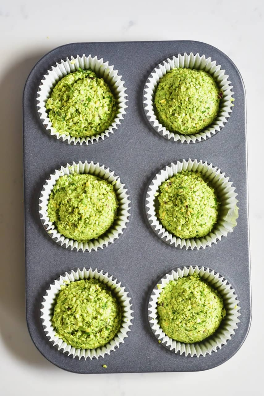 uncooked falafel balls inside muffin tray
