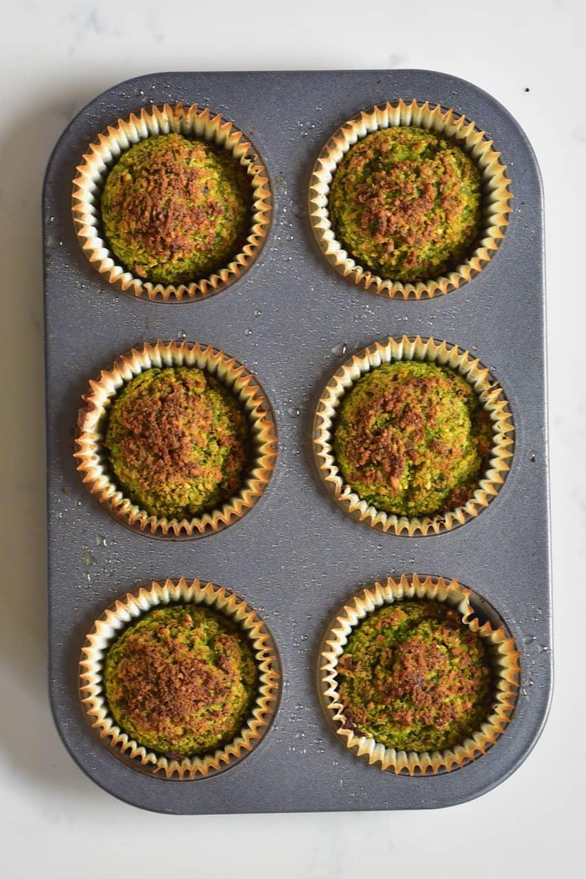large baked falafel balls inside a muffin baking tray
