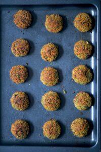 baked falafel balls on a baking tray