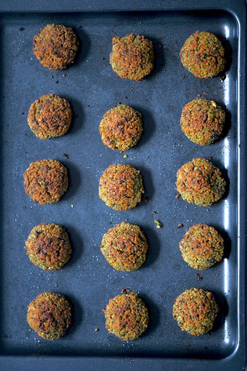 baked falafel balls on a baking tray
