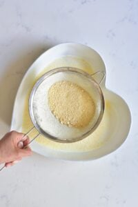 Sieving homemade chickpea flour