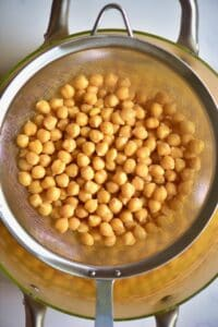 Draining the cooked chickpeas