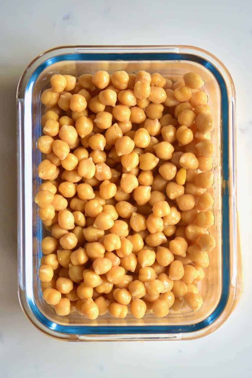 A container with cooked chickpeas