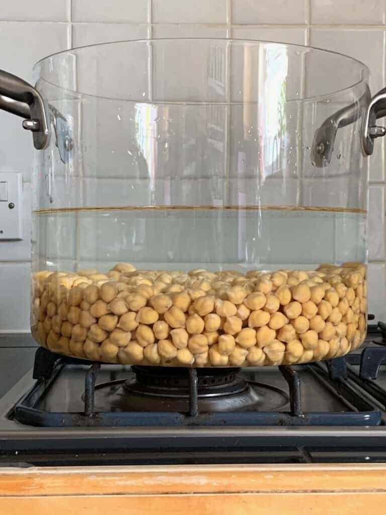 Chickpeas covered with water in a pot