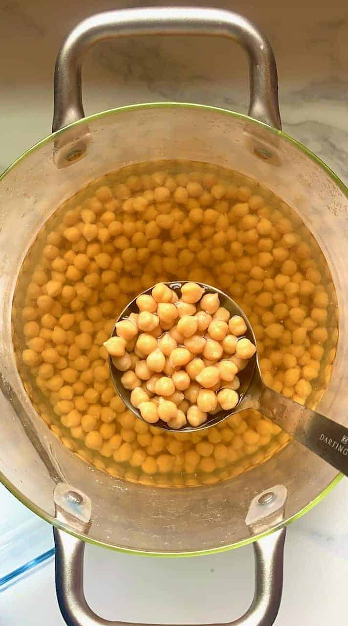 A spoonful of cooked chickpeas