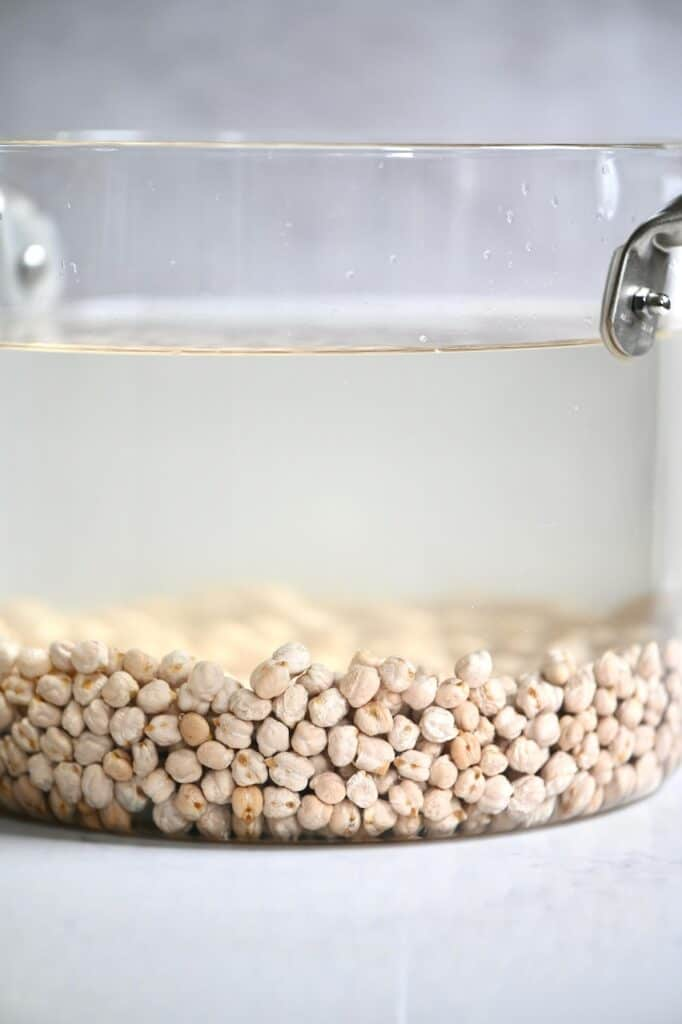 Soaking chickpeas in a pot
