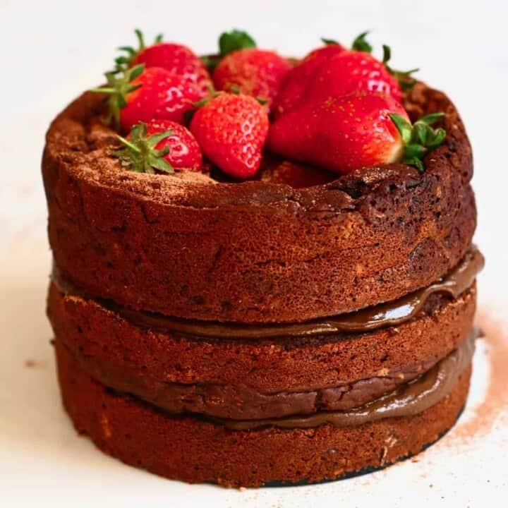 Vegan Gluten Free Chocolate Cake with strawberries on top