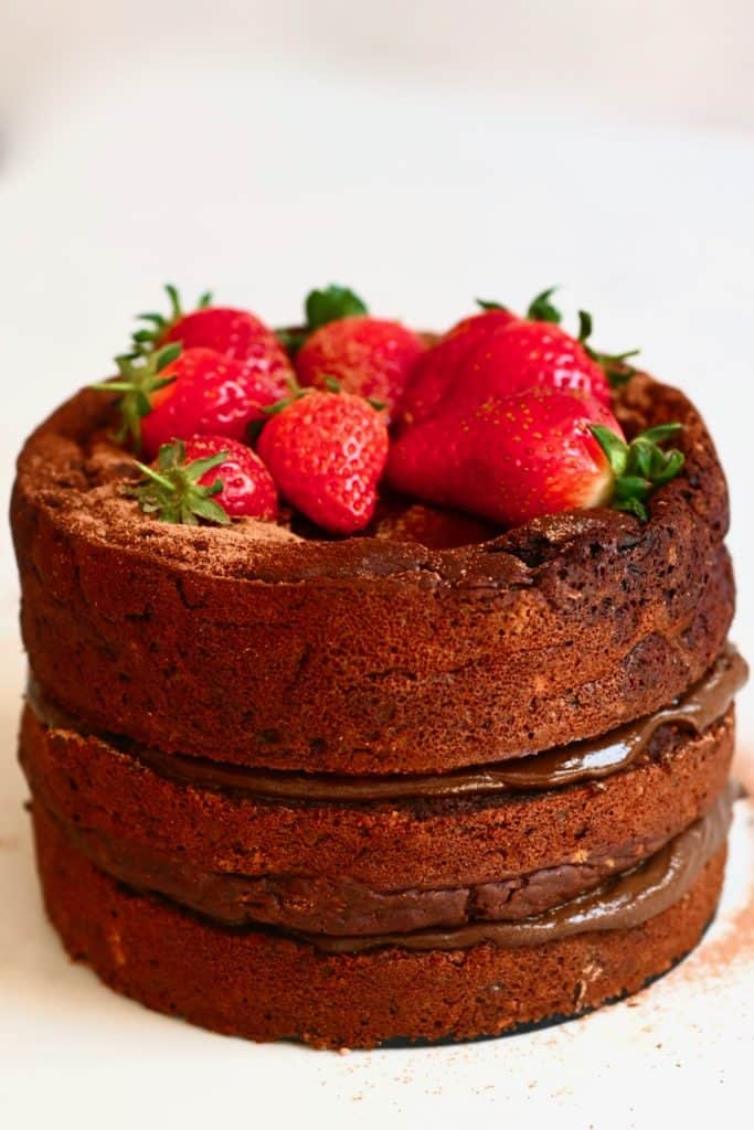 Chocolate cake topped with strawberries