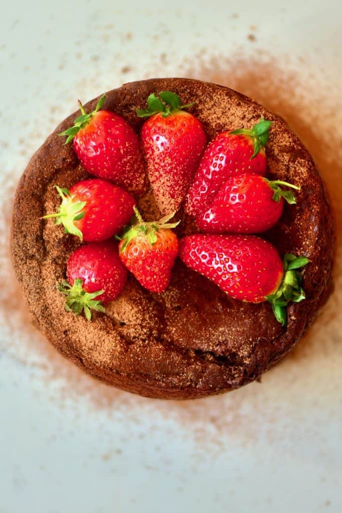 Strawberries on top of chocolate cake