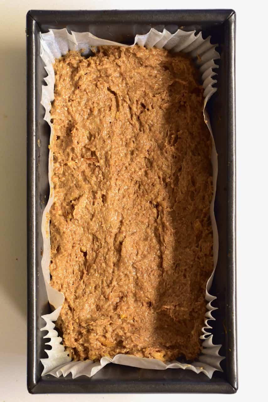 banana bread dough inside loaf tin