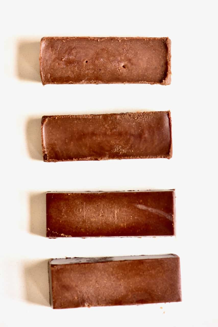 four chocolate fudge bars on white marble top
