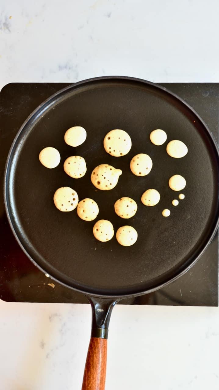 mini pancakes on a pan
