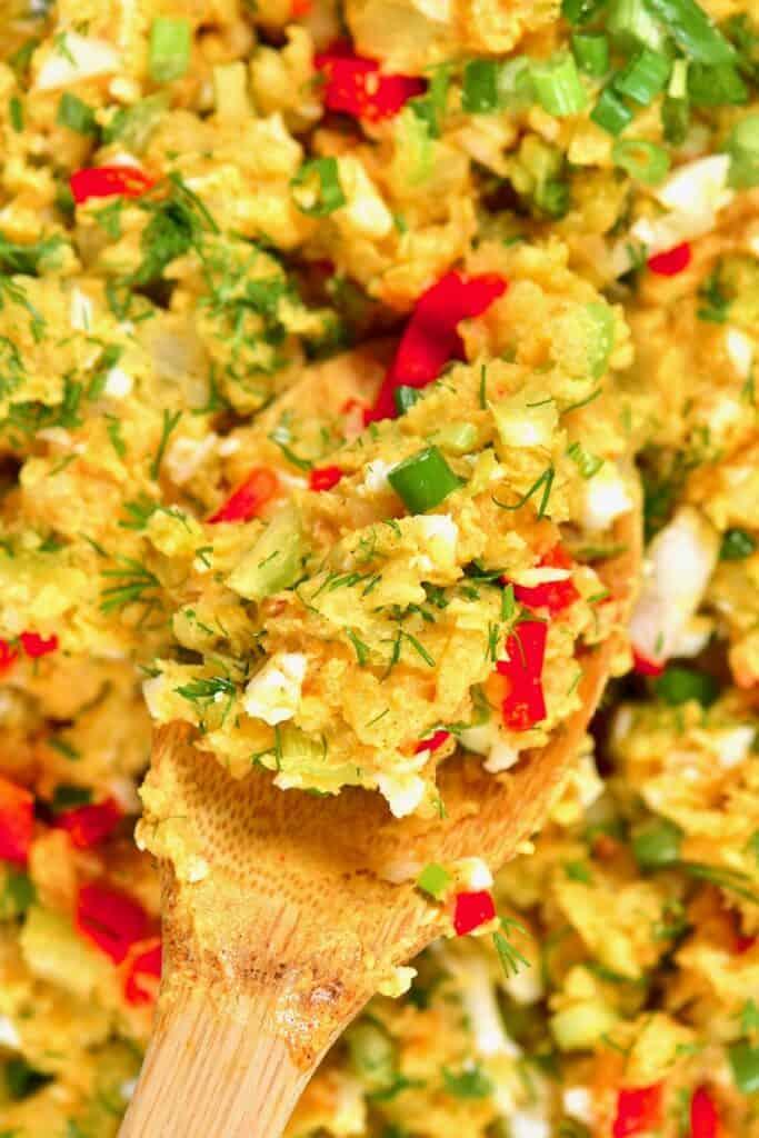 A Spoon of egg potato salad