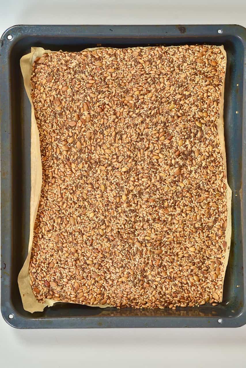 Baked seeded crackers in a tray