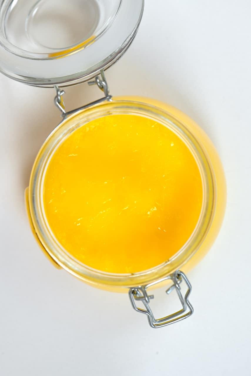 Hardened ghee in an open jar