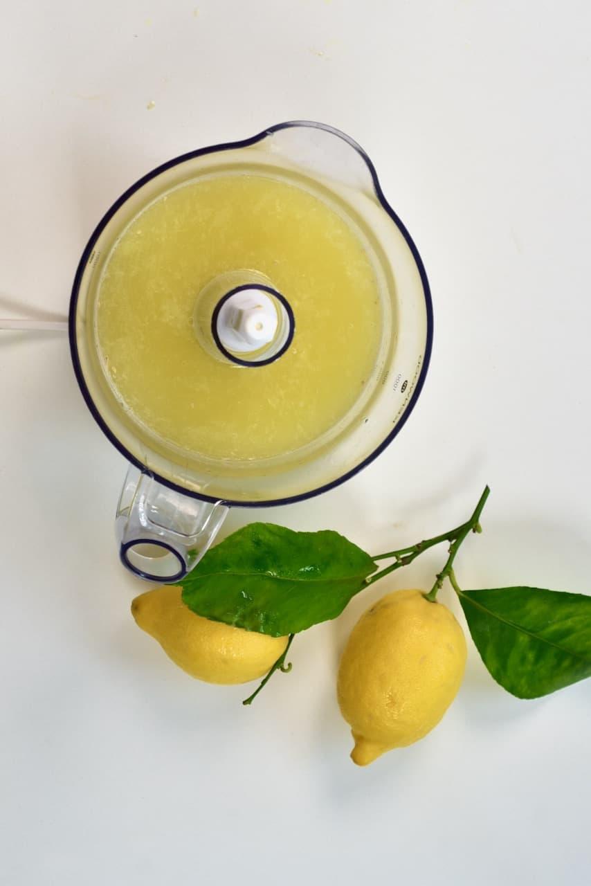Juiced lemons inside a juicer