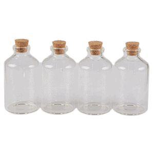 Four glass vials with cork tops