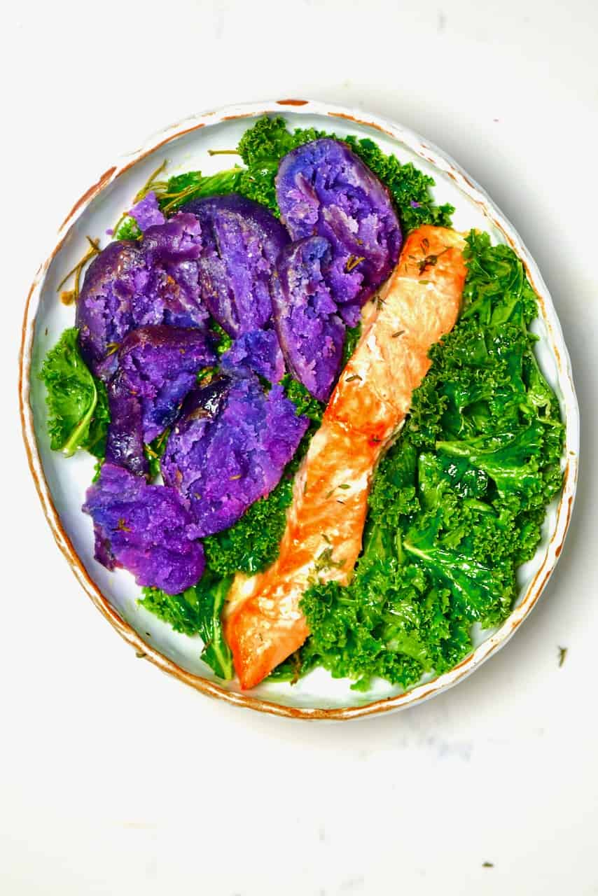 Purple potatoes kale salad and grilled salmon