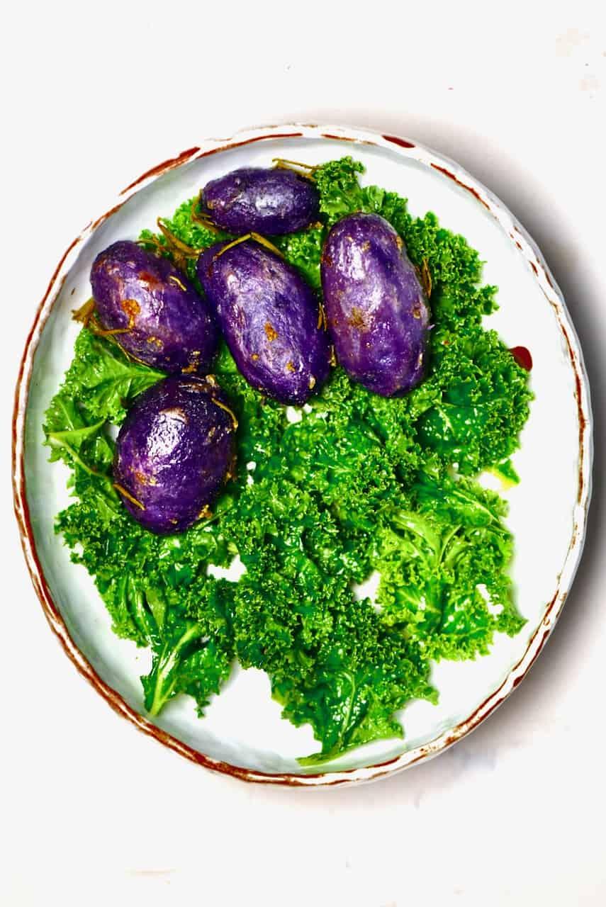 Roasted purple potatoes and kale salad
