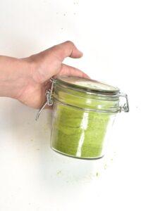 airtight glass jar with green pea powder